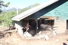 Cabin with serious damage after the natural disaster. http://www.aspenlodge.net/index.php/news/198-restore-aspen-lodge