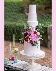custom boho wedding cake with lace and handcrafted flowers