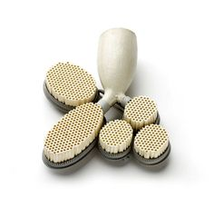 Christel van der Laan  Brooch: Holy Smoke 2010  Painted silver, ceramic honeycomb block, old clay pipe