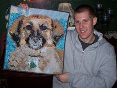 My son, Rusty, and the portrait quilt of his pup, Reese.