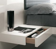 Floating bedside table...      http://www.minimalisti.com/bedroom/12/top-5-bedside-tables-for-a-bedroom.html