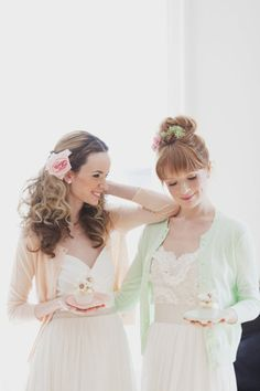 I could have gold or tan wedding dresses with pastel cardigans for a pastel winter wedding