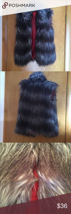 😳 SALE! 😳 😍Gorgeous😍 Faux Fur Vest Stay stylin as Jack Frost nips in this very gently used faux fur vest. Comes with hook and eye closure that is well hidden by the fur. Submit a reasonable offer for consideration today! 5|48 Jackets & Coats Vests