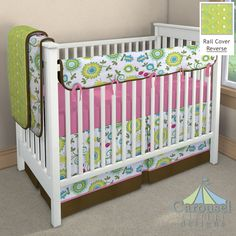 Crib bedding in Turquoise Floral, Citrus Pom Poms, Chocolate Satin Charmeuse, Bright Pink Pindot. Created using the Nursery Designer® by Carousel Designs where you mix and match from hundreds of fabrics to create your own unique baby bedding. #carouseldesigns