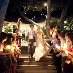 Brides.com: . Pillar Candles. A nighttime ceremony creates the perfect opportunity for guests to light the way out with romantic candles. May work better with electric candles  Browse more romantic real weddings.