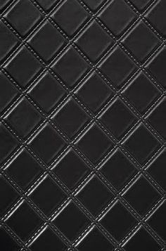 Black, quilted wallpaper