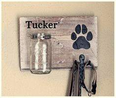 Perfect for the dog lover in your life! This rustic, personalized dog treat & leash holder features a wide mouth, quart-sized Mason jar for treats