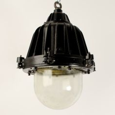 A run of heavy cast-iron and aluminium pendant lights with heavy duty well glass, labelled 'The Walsall'. Removed from a 1950's factory in The Midlands. Newly powdercoated in matt black.  Price£420.00 +VAT Dimensions54cm high x 34cm diameter