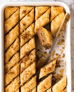 Nadire Atas On Baklava Desserts Layers upon layers of flaky buttery pastry with crushed nuts soaked in a honey lemon syrup. The iconic Baklava is astonishingly straight forward to make! Brownie Desserts, Just Desserts, Smores Dessert, Pastry Recipes, Cooking Recipes, Arabic Dessert, Arabic Sweets, Arabic Food, Cake Mug