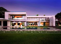 Stunning Waterfront Modern Masterpiece by Ralph Choeff in Miami Beach | HomeDSGN Like this.