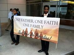One Father, One Faith, One Family Banner held by two of my dear spiritual brothers. I don't know them yet, but I will, Jehovah permitting! Wonderful!,