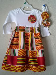 Hey, I found this really awesome Etsy listing at https://www.etsy.com/listing/201030600/africa-print-kente-onesies-dress-with