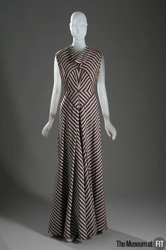 1930's evening dress: by Elizabeth Hawes in silk brocade, c. 1936; evening gowns always reached the floor, usually with bias cuts, bare-backed cut low to the waist, and halter-type sleeveless bodices