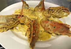 Greek 'Moreton Bay Bugs' Cooked in a creamy sweet chilli sauce and served on a bed of fresh pasta