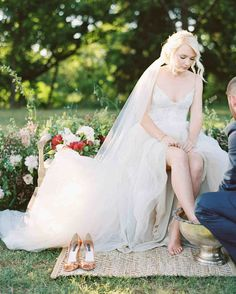 "A Romantic, Flower-Filled Wedding in Oklahoma | Martha Stewart Weddings - ""The foot washing was significant to us as a symbol of humility and selfless love,"" Luke explains of the ritual incorporated in to the service. ""The idea came from Jesus washing the feet of his disciples 2000 years ago. During that time, typically a servant would clean his master's feet. But here, we saw the master washing the feet of all his disciples. We wanted to imitate this act."""