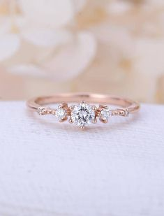 Unique engagement ring rose gold Vintage cluster Moissanite engagement ring women Antique diamond wedding Valentines day gift for her Description: - Vintage style diamond ring - Natural Conflict free diamonds. - comfortable band Moissanite Size: 4mm Forever One(D-E-F) Natural diamond