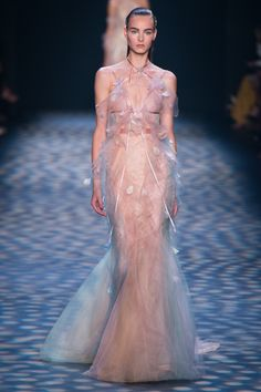Marchesa Spring 2017 Georgina Chapman and Keren Craig like to filter their vision of femininity through a rose-tinted lens, and today they opened their show on a classically pretty pink note. The overarching inspiration: started with sunrise, and the colors that appear in the sky from dusk to dawn; a paint box of lilac, light blue, and blush pink that was touched at times with an iridescent finish. the mood was more golden-hour than mid-day sun