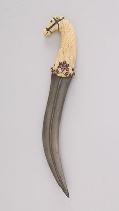 """met-armsarmor:  """"Dagger (Jambiya), Arms and Armor  Medium: Steel, ivory (elephant), silver, ruby, rose quartz  Bequest of George C. Stone, 1935 Metropolitan Museum of Art, New York, NY  http://www.metmuseum.org/art/collection/search/31837  """""""