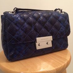 Brand New Michael Kors Bag Michael Kors Gorgeous electric blue bag.  Originals tags and packaging attached.  MSRP $348.00!  You won't even pay half of that.  First come first serve.  Plenty of pockets, zipper pouch in center and more.  No trades.  Great deal.  This is authentic not a fake. MICHAEL Michael Kors Bags Shoulder Bags
