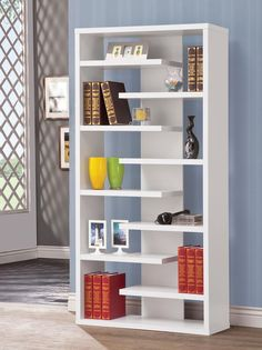 This beautifully designed bookcase creates many options for storing and displaying your items. Use the staggering shelves to add stylish storage to your living room, office, or hallway. This sleek semi-backless bookcase features a center back panel. Decor, Furniture, Bookcase, Bookshelf Decor, Shelves, Home Furniture, Shelf Design, Home Decor, Bookshelf Design