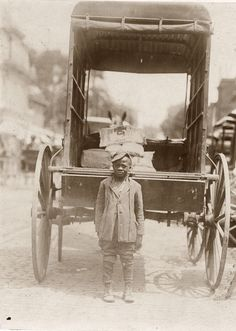 1910. Young boy, seven years old working for a Miller, moving 25 pound bags of flour. He made 25 cents a week.