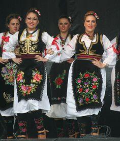 Pretty Serbian dancing girls in their folk costumes -