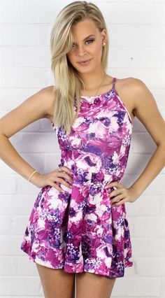 The sweetest romper we've ever seen! A refreshing pattern of purple, pink and white flowers, this delicate romper stands out in the sea of others you'll see this Summer. With a flattering halter top t