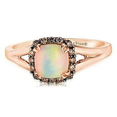 Indulge in the elegant beauty of Chocolate by Petite Le Vian. This stunning ring is crafted from sumptuous 14ct Strawberry Gold and has an exquisitely colourful Chocolate Opal at its centre surrounded by a halo of deliciously dazzling Chocolate Diamonds for breathtaking beauty and unique style.