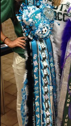 Custom Homecoming Mums are my specialty! There are no limitations to size, shape, color, or activities! These mums are fully customizable