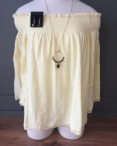 Check out this sweet yellow off the shoulder top! Perfect for spring
