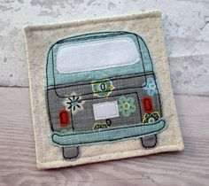 A fabric camper van coaster in blue, grey and mustard fabrics. This fabric camper van coaster will be the perfect gift for any vw enthusiast! This fabric drinks coaster will be the perfect gift for someone special and is an ideal present this festive s. Quilted Coasters, Fabric Coasters, Embroidery Cards, Free Motion Embroidery, Fabric Cards, Fabric Gifts, Homemade Coasters, Sewing Crafts, Sewing Projects