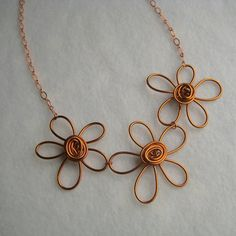 Free Form Copper Wire Flower Necklace.  Designs with dazzle.