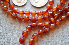 A personal favorite from my Etsy shop https://www.etsy.com/listing/187359090/orange-jade-hand-knotted-jaap-mala-beads