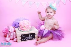 Baby girl cake smash photo shoot. First Birthday.