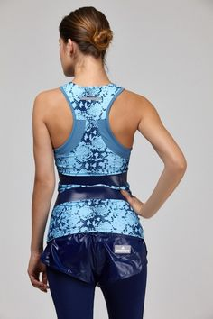 Tanned backknotted chocolette in turquoise faux boa racerback & matching running shorts, navy leggings