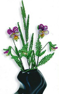 A different type of beaded flower and leaves. Easy instructions.