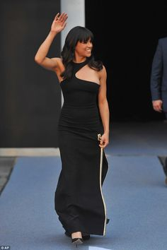 Chic: The dress featured a zip-detail split down one side which she wore with black heels...