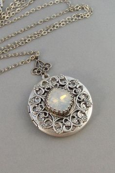 Under The Moon Locket- Something appealing and vintage-esque about this locket pendant...: