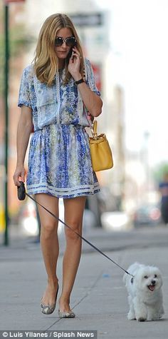 Out and about: Palermo chatted on her smartphone while walking her dog...