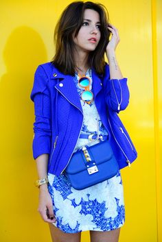 Love how her leather blue crossbody bag matches with her blue belt and jacket.