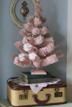 Mini pink tree- this would be a perfect Victorian tree in my bedroom!! Love the vintage suitcase under it as well!