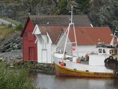 Norway: seahouses and fishing boat.  Where in Bømlo do you think this photo is taken?