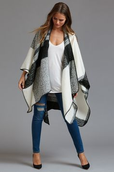 Look stylish and keep hot in this plaid poncho.