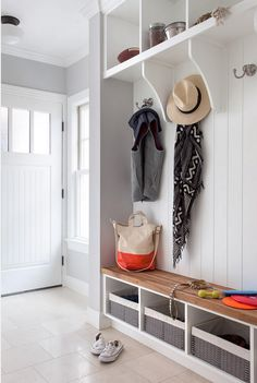 Mud room Ideas. Mud room sources. Mudroom Resources. The wall paint color in this mudroom is Stonington Gray HC-170 by Benjamin Moore. Mud room cabinet is painted in Benjamin Moore Simply White. The mudroom tile flooring is Crema Marfil Honed 12x12 floor tile. The mudroom hooks are from Restoration Hardware. #mudroom. #BenjaminMooreStoningtonGray #BMHC170