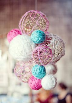 This is soooo cute and easy to create!  Just blow up a balloon to the size you want, dip your yarn in some watered down glue and wrap it around the balloon....when dried, pop the balloon.  Super Cute!!!