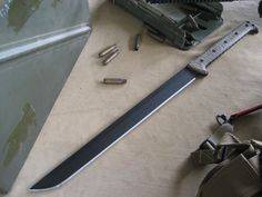 Miller Bros. Blades (MBB)  M-25 Waki sized tactical short sword.