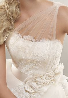 WEDDING DRESS IDEA: tulle done well - this one shoulder bodice adds femininity to this pretty dress. I love the small rosettes tied with a satin ribbon.
