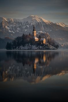 Sunrise ;A small island in the middle of the lake Bled is home to the Assumption of Mary Pilgrimage Church.