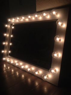 """Lighted vanity makeup mirror called Silver Belle. Excellent mirror for your beauty needs. Frame size: 25"""" x 18"""" x 3/4"""" , weighs about 9 pounds. This item can take up to 4-5 weeks to make and ship. (Su"""