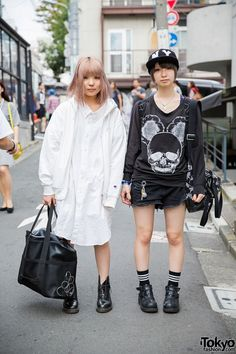 Harajuku Girls in Glad News, Mint Neko, Ne-Net & Dr. Martens. We met these two 18-year-old students in Harajuku when they dressed in opposing black and white outfits. (Tokyo Fashion, 2014)